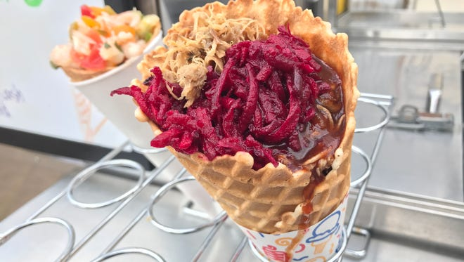 Waffle cones stuffed with pulled pork and shrimp ceviche are served by a new food cart called Coneucopia.