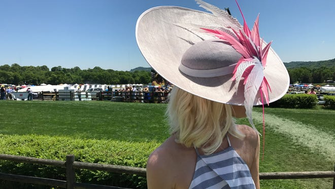 Amber Williams shows off her hat at the 76th annual Steeplechase Saturday, May 13, 2017.