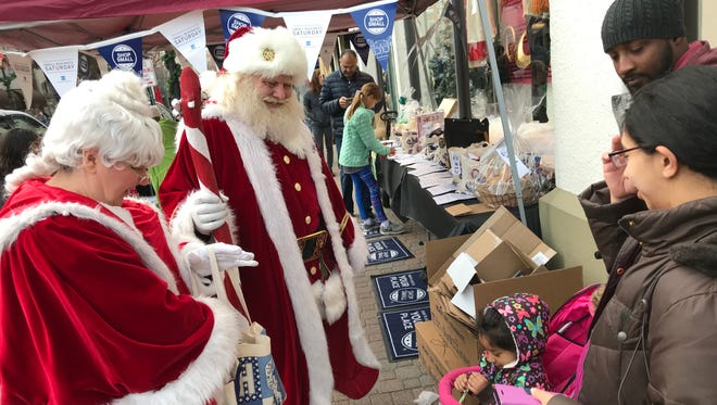 Santa and Mrs. Claus visit with shoppers during Small Business Saturday events in Montclair.