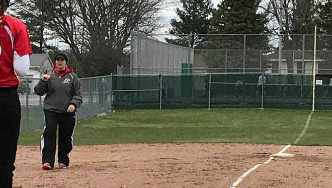 Pleasant softball coach Jenni Garner talks to a batter during a regular season game at home against Mount Gilead. Gardner was named All-Star Marion County Softball Coach of the Year.