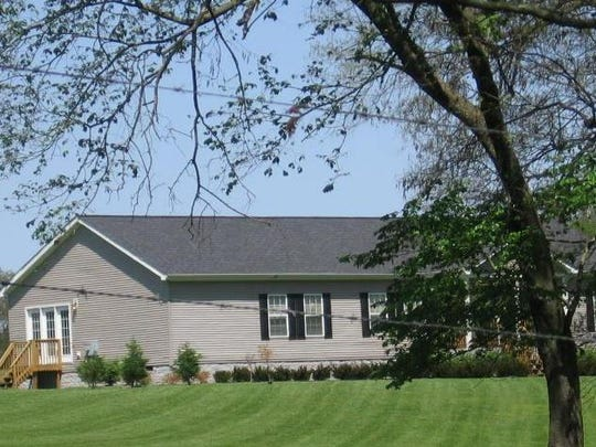 This home at 3605 Hoggett Ford Road sits on property eyed for a residential project.