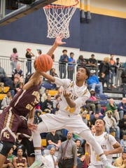 Battle Creek Central's Jahmiel Wade (10) goes for the hoop during Friday nights game against Kalamazoo Central.