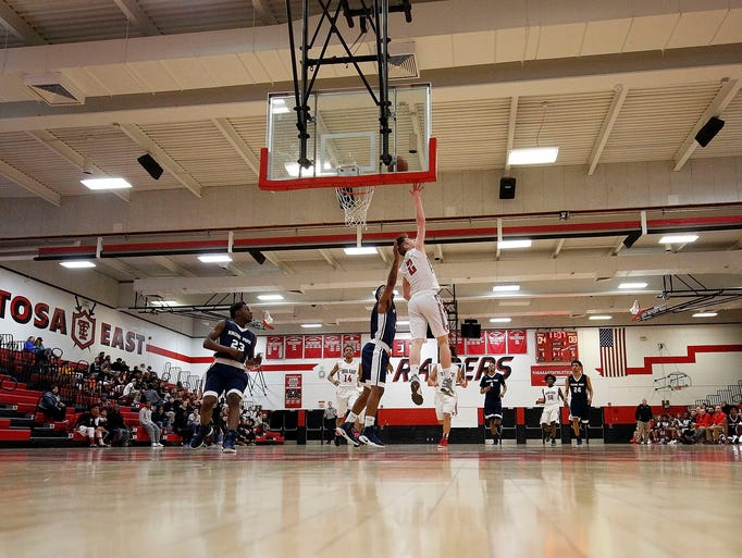 Wauwatosa East's Blake Kratzer shoots over Racine Park's