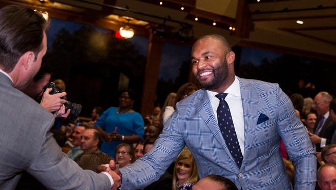 Former Seminole Myron Rolle accepts congratulations Friday during the FSU College of Medicine Match Day.