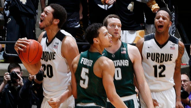 Purdue's A.J. Hammons emerges with the ball at the end of MSU's 82-81 loss in overtime Tuesday in West Lafayette, Ind.