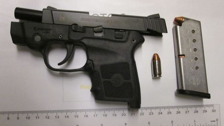This gun and bullets were taken from a woman at Norfolk