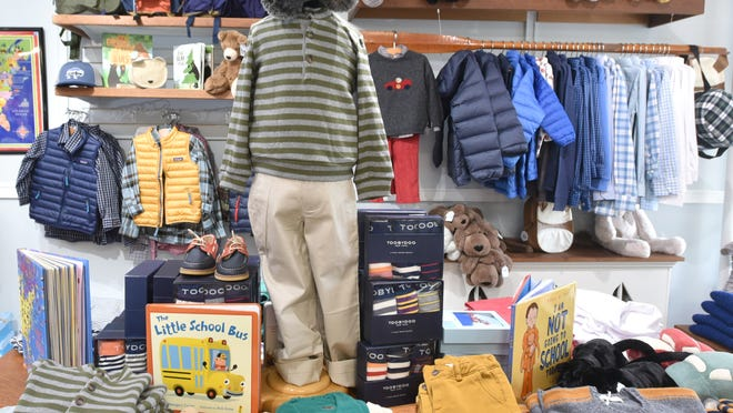 Popular back-to-school items at Pocket Full of Posies in Osterville have been cozy clothing for children, items to outfit a desk area, crafts, puzzles - and masks - according to owner Jennifer Wass.