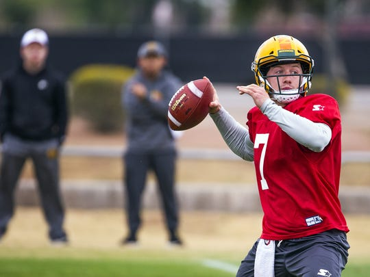 Quarterback John Wolford throws a pass during Arizona