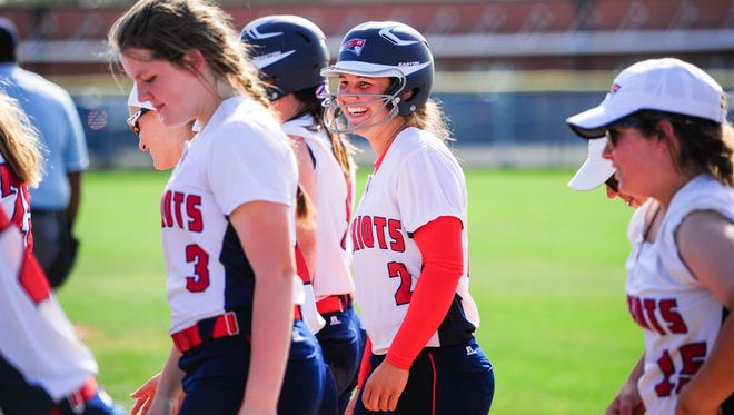 North Vermilion's Kaylee Lopez (2) is all smiles walking off the field after one of her two three-run homers in Friday's 8-1 win over Notre Dame.