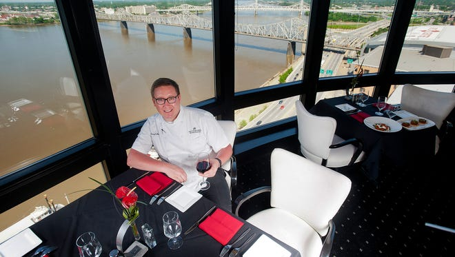 Rivue Restaurant & Lounge Executive Chef Kendall Linhart sits in one of two revolving dining rooms offering spectacular views of the Ohio River from the 25th floor of the Galt House Hotel.