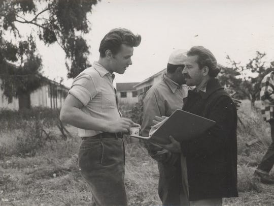 """James Dean (left) goes over the script for Elia Kazan's """"East of Eden"""" in 1954. The film will be shown on April 29 as part of the Wednesday Evening Film Series at the Historic Elsinore Theatre."""