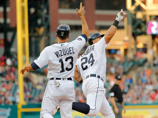 Detroit Tigers' Miguel Cabrera (24) celebrates his three-run home run against the Kansas City Royals with first base coach Omar Vizquel (13) during the third inning of a baseball game in Detroit, Tuesday, June 27, 2017. (AP Photo/Paul Sancya)