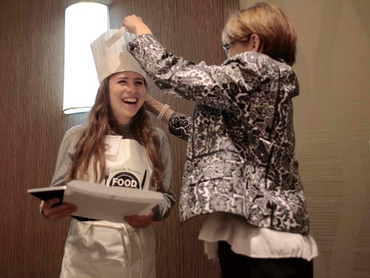 Daniela Friedman from Ann Arbor is given a chef's hat