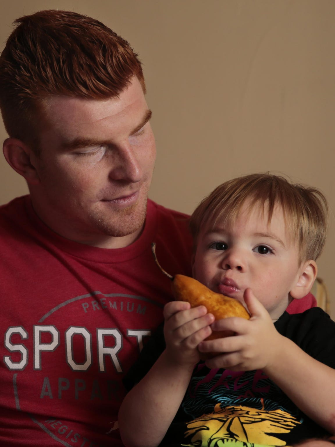 Andy Dalton plays with his son Noah at their home in