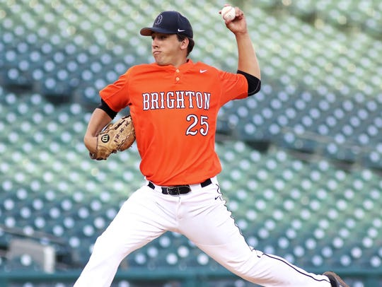 Brighton's Cameron Tullar works from the Comerica Park