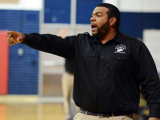 ayside boys basketball coach Danny Miller directs his team during a game against Cocoa Beach.