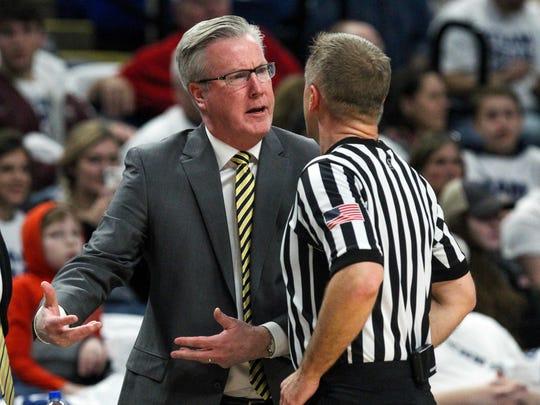 Iowa Hawkeyes head coach Fran McCaffery argues a call
