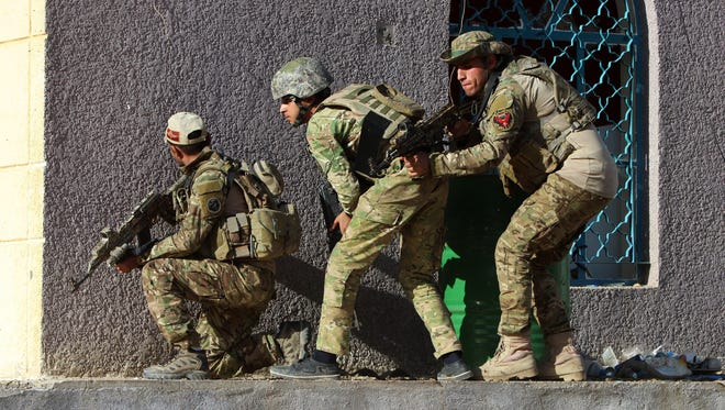 Members of the Iraqi armed forces take up positions during a military operation in the village of Sigariya, near Ramadi, west of Baghdad, Nov. 15, 2015. The Iraqi armed forces, backed by militias and coalition aristrikes, continue efforts to retake the Anbar provincial capital of Ramadi, captured by the Islamic State. However efforts to date have stalled due in part of lack of training of the Iraqi forces and Islamic State abilities to be resupplied as a result of failed attempts by government forces to encircle the city, sources report.