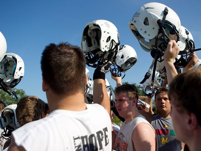 Stratford football players huddle up during football practice at Stratford High School, Tuesday, August 5, 2014.