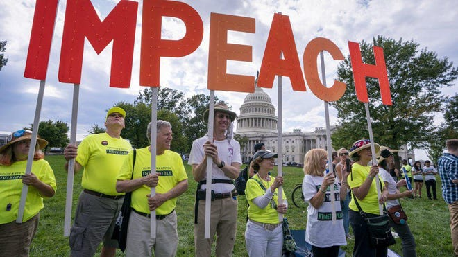 Activists rally for the impeachment of President Donald Trump, at the Capitol in Washington last September.