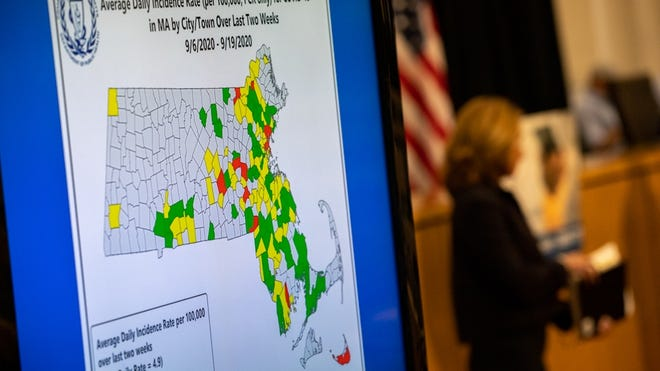 "A map displayed at the governor's Tuesday news conference illustrated the COVID-19 transmission rates in cities and towns. Framingham, Boston, Lowell and Springfield were among thoses re-shaded as ""red"" on the map, signifying more than eight cases per 100,000 people."