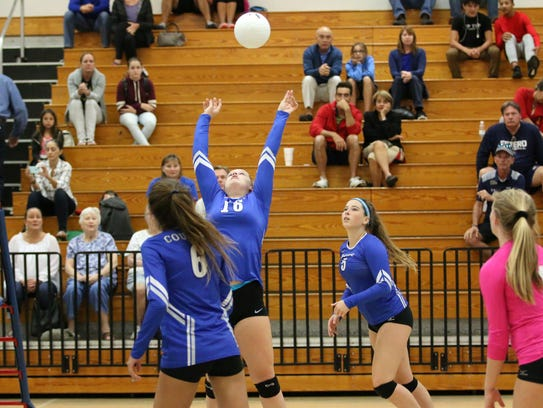 The Barron Collier volleyball team sets up an attack