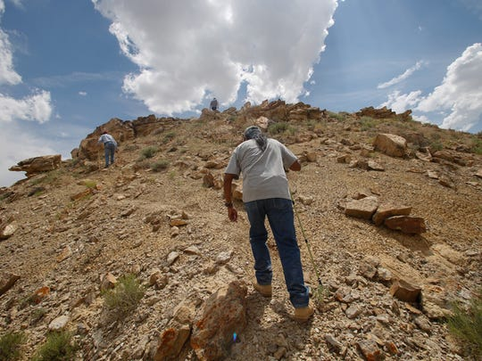 Everrett Garcia Sr., a member of the Acoma Historic Preservation Office board, climbs a hill on June 23, 2015, to reach a portion of Pierre's Ruins 20 miles north of Chaco Culture National Historical Park.
