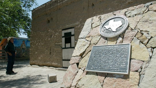 A historic marker in front of the jail in San Elizario