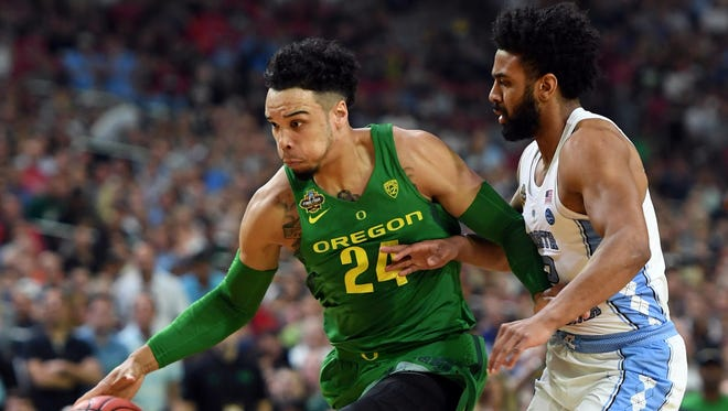 Oregon Ducks forward Dillon Brooks (24) drives to the basket against North Carolina Tar Heels guard Joel Berry II (2) during the first half in the semifinals of the 2017 NCAA Men's Final Four.