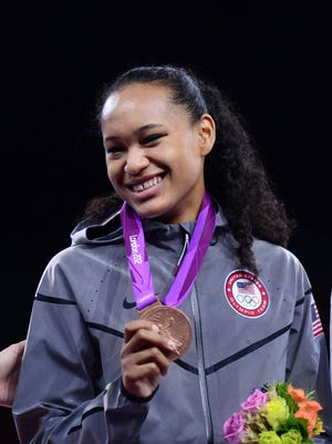 South Dakota's Paige McPherson  celebrates with a bronze medal in the women's 67kg class during the London 2012 Olympic Games. She is competing in taekwondo in Rio.