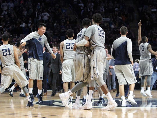 Penn State Nittany Lion players celebrate after defeating Indiana 68-63 at Bryce Jordan Center. Penn State defeated Indiana 68-63.