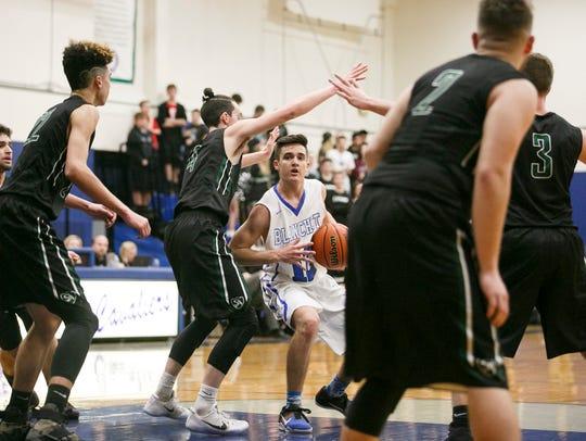 Blanchet's RJ Veliz drives through Salem Academy defense