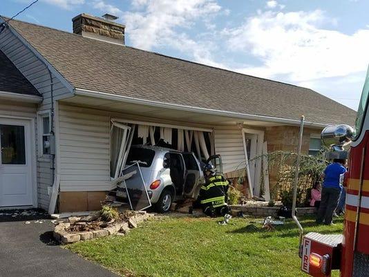 Car crash into home