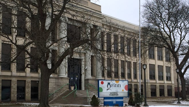 Finn Academy charter school says it will remain at the former Ernie Davis Middle School, even if the building is sold.