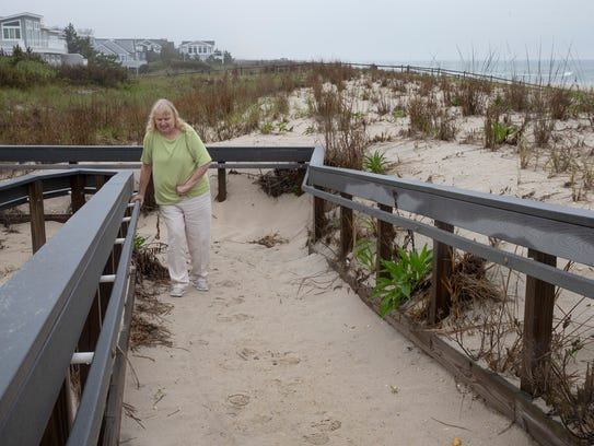 Greber works hard to get over sand on handicap access