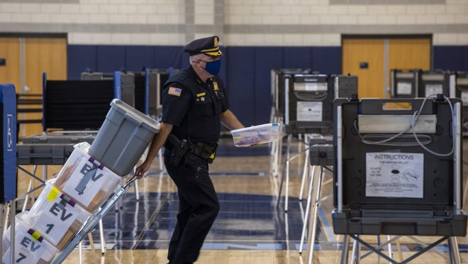 Franklin Chief of Police Thomas Lynch rolls ballots into Franklin High School Thursday afternoon.