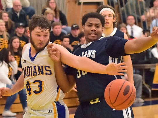 Logan Weibley (43) of Waynesboro and CASHS Tyron Williams battle for a loose ball. Local teams opened their season during the Franklin County Basketball Tip-off Tournament at Greencastle, Friday, December 8, 2017.