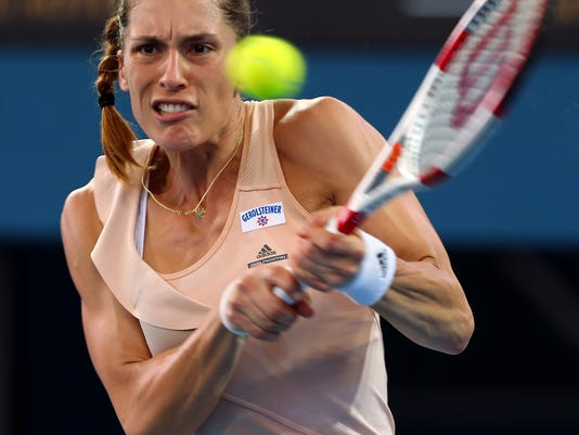 Andrea Petkovic of Germany plays a shot during her first round match against Estonia's Kaia Kanepi at the Brisbane International tennis tournament in Brisbane, Australia, Sunday, Jan. 4, 2015. (AP Photo/Tertius Pickard)