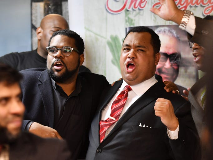 Coleman Young II, right, stands with the Rev. Charles