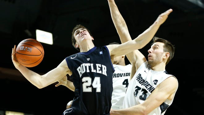 Butler Bulldogs guard Kellen Dunham (24) shoots the ball as Providence Friars forward Carson Desrosiers (33) and guard Josh Fortune (4) defend during the second half at Dunkin Donuts Center.