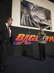 In this handout image provided by NASA, NASA Deputy Administrator Lori Garver (R) and President and founder of Bigelow Aerospace Robert T. Bigelow announce a planned addition to the International Space Station that will use the orbiting laboratory to test expandable space habitat technology during a press conference held at Bigelow Aerospace on January 16, 2013 in Las Vegas, Nevada.