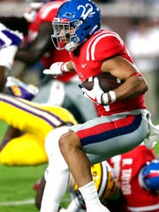 Mississippi running back Jordan Wilkins (22) runs for a first down in the first half of an NCAA college football game against LSU in Oxford, Miss., Saturday, Oct. 21, 2017. (AP Photo/Rogelio V. Solis)