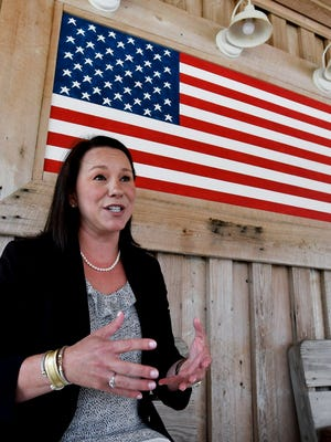 U.S. Rep. Martha Roby, R-Ala., pauses to talk with the media while campaigning at a fish fry in Andalusia, Ala., on May 30, 2018.