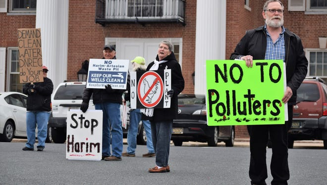 Sussex County residents protested in Georgetown on Monday night in advance of a public hearing considering Allen Harim Foods LLC's plans to debone chickens at a former pickle plant near Millsboro.