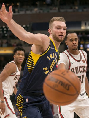 Domantas Sabonis watches as a ball he'd been working falls out of bounds after a tip from John Henson (back), Milwaukee Bucks at Indiana Pacers, Bankers Life Fieldhouse, Indianapolis, Monday, March 5, 2018.