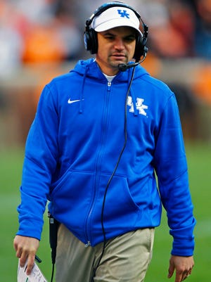 Kentucky offensive coordinator Neal Brown walks the sideline during an NCAA college football game against Tennessee Saturday, Nov. 15, 2014 in Knoxville, Tenn. (AP Photo/Wade Payne)