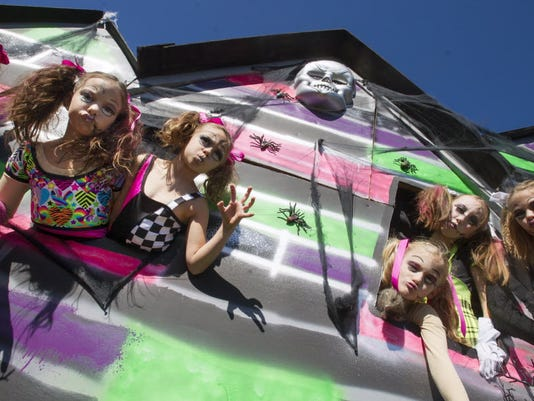 The Extravaster Dance Company dolls pose during last year's York Halloween Parade. The event returns to downtown York Oct. 25.