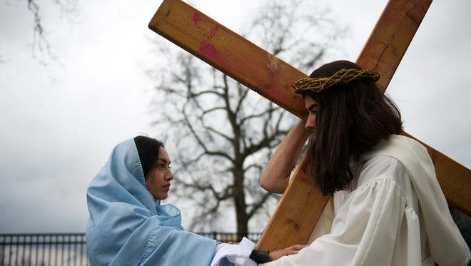 Mary (played by Maria Aldama, 14) comforts Jesus (played by Jeremiah Rivas, 17) at the fourth station as Divine Mercy Parish and Immaculate Heart Church perform living Stations of the Cross Friday, March 25 in Vineland.