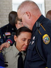 People console each other at Easthaven Baptist Church in Brookhaven on Thursday following the funeral of Lincoln County Sheriff's Deputy William Durr, who was among eight people gunned down during a countywide killing spree that began Saturday night.