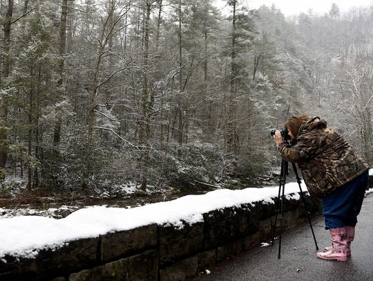 Faye Sykes of Clintwood, Va., takes photographs in